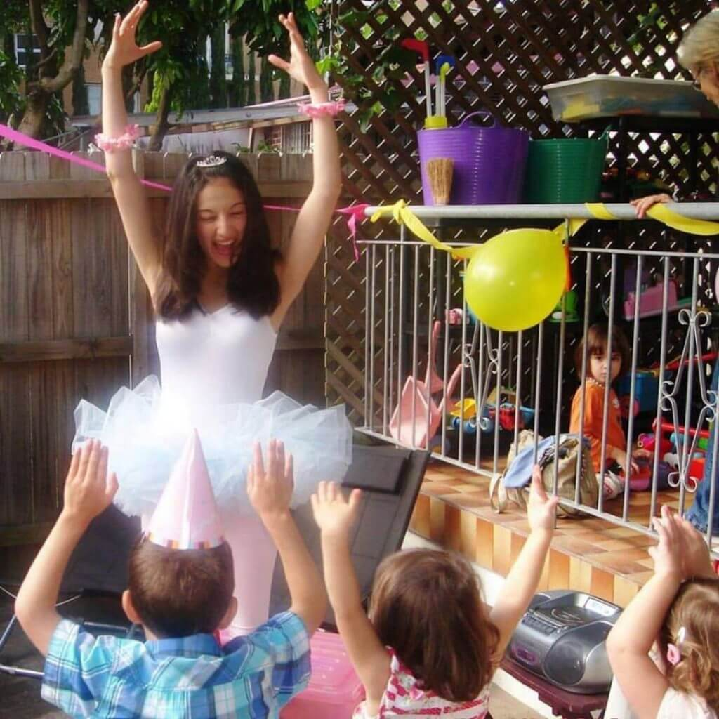 Ballerina dancing with children